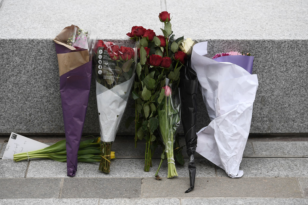 . LONDON, ENGLAND - MARCH 23:  Floral tributes are left near New Scotland Yard on March 23, 2017 in London, England.  Four people have been killed and around 40 people injured following yesterday\'s attack by the Houses of Parliament in Westminster.  (Photo by Carl Court/Getty Images)