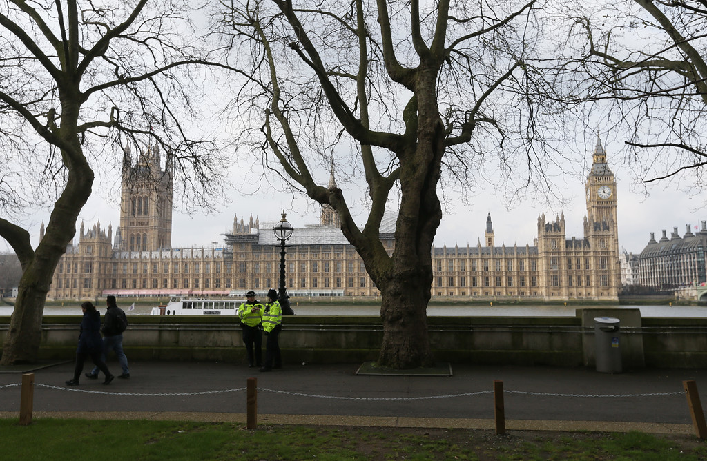 . Police line the embankment with parliament seen across the River Thames, in London, Thursday March 23, 2017.  On Wednesday a knife-wielding man went on a deadly rampage, first driving a car into pedestrians then stabbing a police officer to death before being fatally shot by police within Parliament\'s grounds in London.  (AP Photo/Tim Ireland)