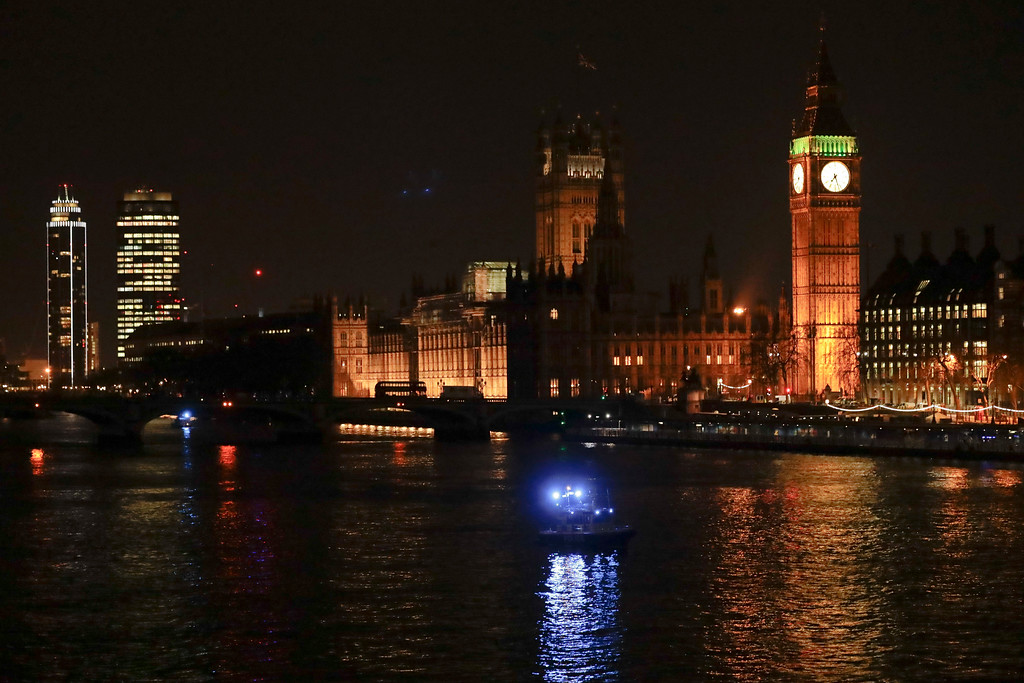 ". The River Thames backdropped by the Houses of Parliament and Elizabeth Tower containing the bell know as ""Big Ben\"" in London, Wednesday, March 22, 2017. London police say they are treating a gun and knife incident at Britain\'s Parliament \""as a terrorist incident until we know otherwise.\"" The Metropolitan Police says in a statement that the incident is ongoing. It is urging people to stay away from the area. Officials say a man with a knife attacked a police officer at Parliament and was shot by officers. Nearby, witnesses say a vehicle struck several people on the Westminster Bridge. (AP Photo/ Matt Dunham)"