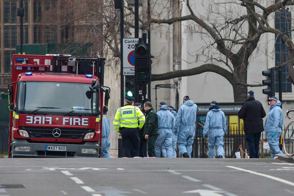 . LONDON, ENGLAND - MARCH 23:  Police officers in forensics suits work in Parliament Square following yesterday\'s attack in which one police officer was killed on March 23, 2017 in London, England. Four people have been killed and around 40 people injured following yesterday\'s attack by the Houses of Parliament in Westminster. (Photo by Jack Taylor/Getty Images)