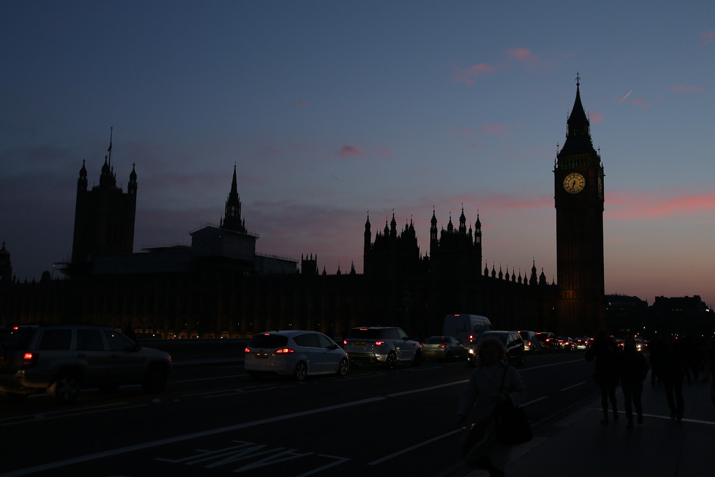 . A picture shows the Union flag atop the Houses of Parliament flying at half-mast in central London on March 23, 2017.  Britain\'s parliament reopened on Thursday with a minute\'s silence in a gesture of defiance a day after an attacker sowed terror in the heart of Westminster, killing three people before being shot dead. Sombre-looking lawmakers in a packed House of Commons chamber bowed their heads and police officers also marked the silence standing outside the headquarters of London\'s Metropolitan Police nearby. (DANIEL LEAL-OLIVAS/AFP/Getty Images)