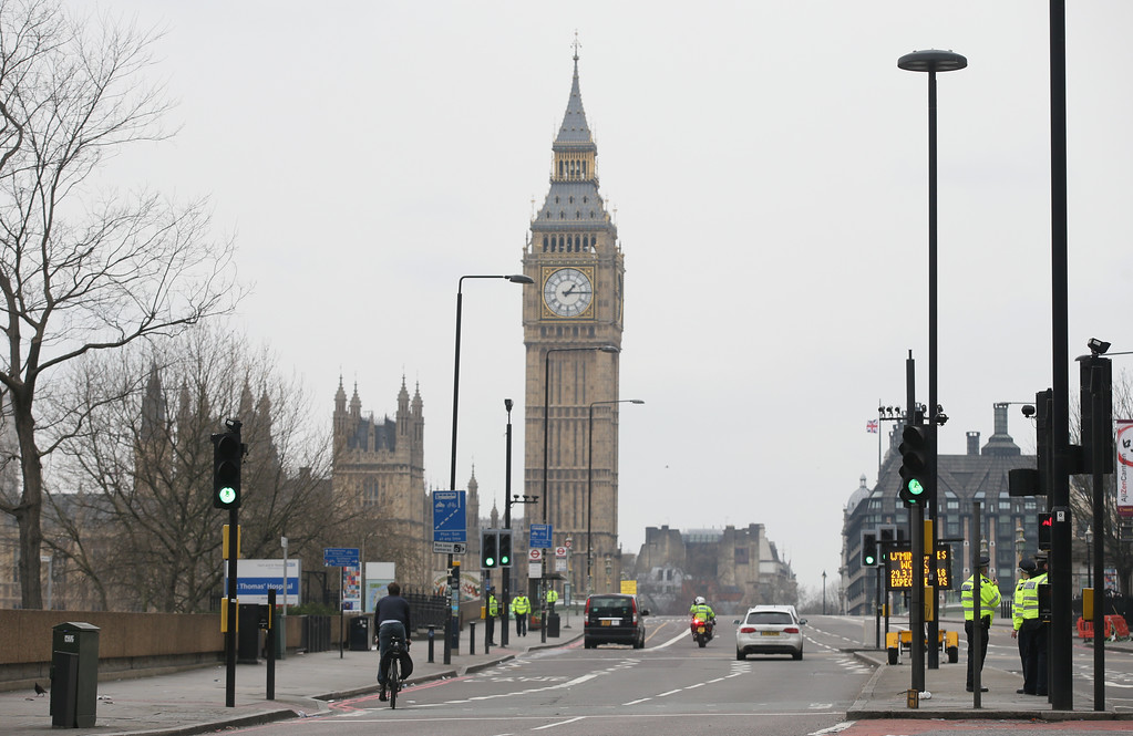 ". Westminster Bridge is re-opened to the public Thursday, March 23, 2017, following an attack on Wednesday when a man drove a car into pedestrians then stabbed a police officer to death before being fatally shot by police within Parliament\'s grounds.  The IS-linked Aamaq news agency said Thursday that the person who carried out the ""attack in front of the British parliament in London was a soldier of the Islamic State.\"" (AP Photo/Tim Ireland)"