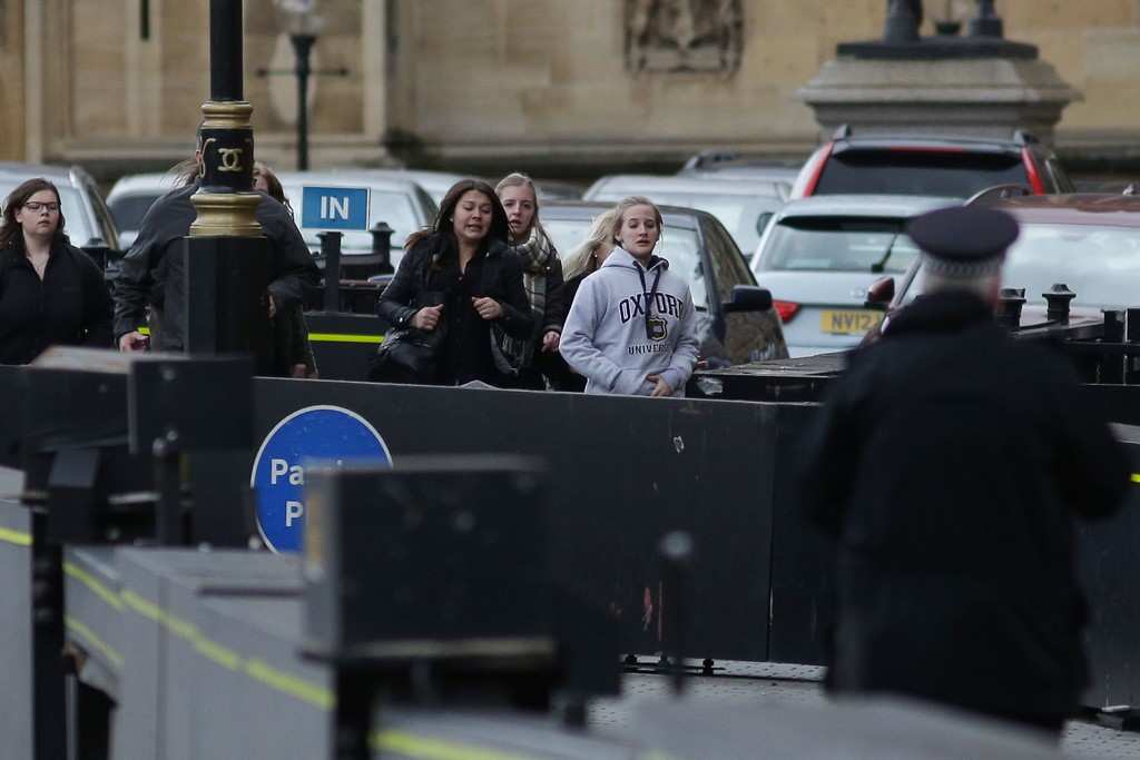 ". People leave after being evacuated from the Houses of Parliament in central London on March 22, 2017 during an emergency incident. British police shot a suspected attacker outside the Houses of Parliament in London on Wednesday after an officer was stabbed in what police said was a ""terrorist\"" incident. One woman has died and others have \""catastrophic\"" injuries following a suspected terror attack outside the British parliament, local media reported on Wednesday citing a junior doctor. (DANIEL LEAL-OLIVAS/AFP/Getty Images)"