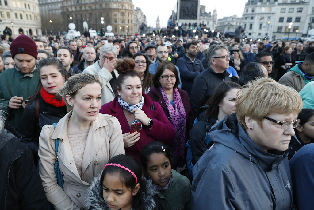. People gather for a vigil in Trafalgar Square in central London on March 23, 2017 in solidarity with the victims of the March 22 terror attack at the British parliament and on Westminster Bridge.  Britain\'s parliament reopened on Thursday with a minute\'s silence in a gesture of defiance a day after an attacker sowed terror in the heart of Westminster, killing three people before being shot dead. Sombre-looking lawmakers in a packed House of Commons chamber bowed their heads and police officers also marked the silence standing outside the headquarters of London\'s Metropolitan Police nearby. (ADRIAN DENNIS/AFP/Getty Images)