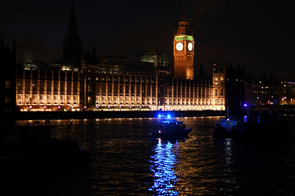 . LONDON, ENGLAND - MARCH 22:  Police boats patrol outside the Houses of Parliament after a terrorist attack on March 22, 2017 in London, England. Four people including a police officer and his attacker have been killed in two related incidents outside the Houses of Parliament and on Westminster Bridge in what Scotland Yard are treating as a terrorist incident.  (Photo by Carl Court/Getty Images)