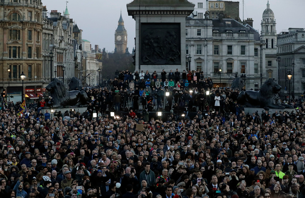 . Crowds gather at a vigil for the victims of Wednesday\'s attack, at Trafalgar Square in London, Thursday, March 23, 2017. The Islamic State group has claimed responsibility for an attack by a man who plowed an SUV into pedestrians and then stabbed a police officer to death on the grounds of Britain\'s Parliament. Mayor Sadiq Khan called for Londoners to attend a candlelit vigil at Trafalgar Square on Thursday evening in solidarity with the victims and their families and to show that London remains united. (AP Photo/Matt Dunham)