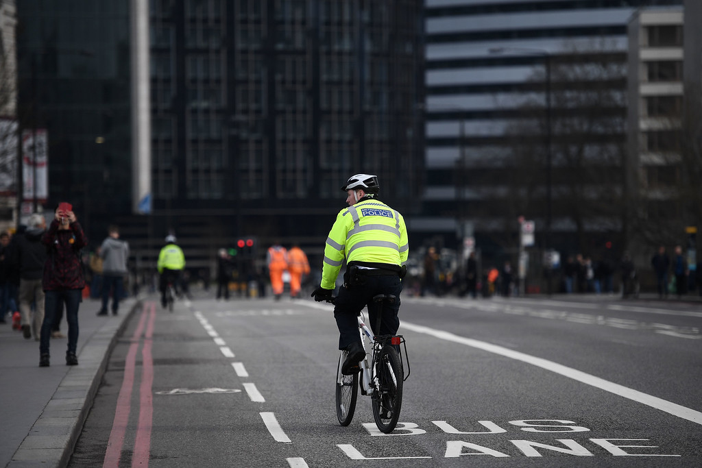 . LONDON, ENGLAND - MARCH 23:  Police cycle over Westminster Bridge as it is opened to the public on March 23, 2017 in London, England.  Four people have been killed and around 40 people injured following yesterday\'s attack by the Houses of Parliament in Westminster.  (Photo by Carl Court/Getty Images)
