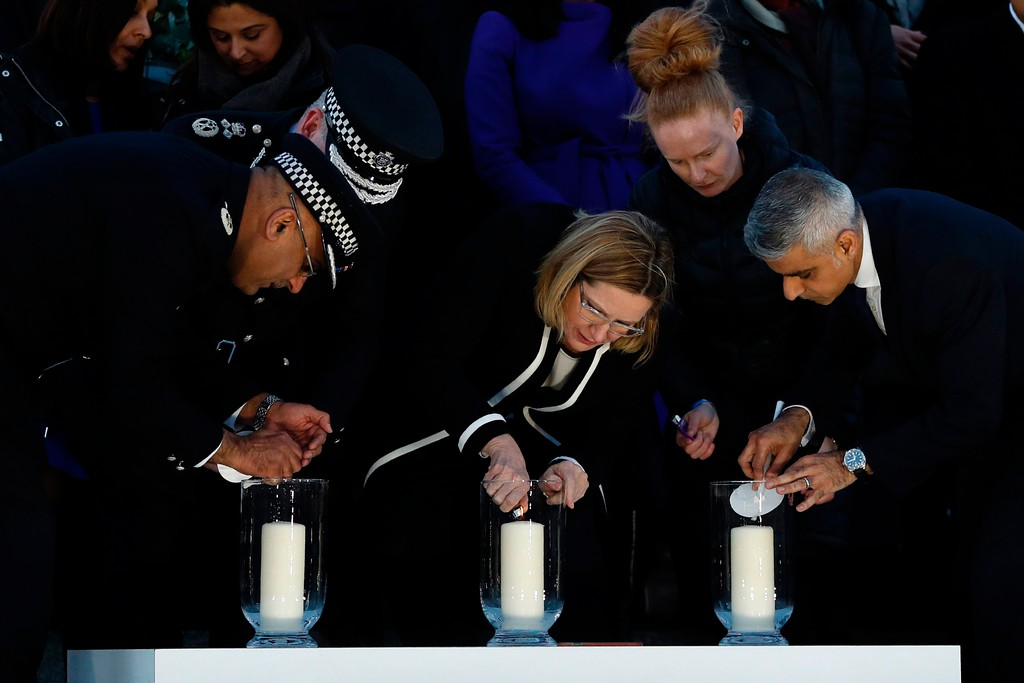 . London Mayor Sadiq Khan (R) , British Home Secretary Amber Rudd (C) and Acting Commissioner of the Metropolitan Police Service Craig Mackey (2L - obscured) light candles during a vigil in Trafalgar Square in central London on March 23, 2017 in solidarity with the victims of the March 22 terror attack at the British parliament and on Westminster Bridge.  Britain\'s parliament reopened on Thursday with a minute\'s silence in a gesture of defiance a day after an attacker sowed terror in the heart of Westminster, killing three people before being shot dead. Sombre-looking lawmakers in a packed House of Commons chamber bowed their heads and police officers also marked the silence standing outside the headquarters of London\'s Metropolitan Police nearby. (ADRIAN DENNIS/AFP/Getty Images)