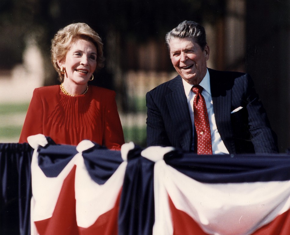 . 11/04/91-Simi Valley--Former first lady Nancy Reagan, and former president Ronald Reagan laugh at a joke durin the Ronald Reagan Presidential Library opening ceremony.(Los Angeles Daily News file photo)