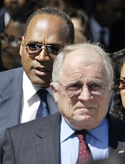 ". O.J. Simpson, who was acquitted of murder charges when represented by Johnnie L. Cochran a decade ago, follows attorney F. Lee Bailey, another member of Simpson\'s ""Dream Team,\"" as they leave the funeral service of the famed attorney at West Angeles Cathedral in Los Angeles\' Crenshaw District Wednesday, April 6, 2005. Others are unidentifid.  (AP Photo/Nick Ut)"