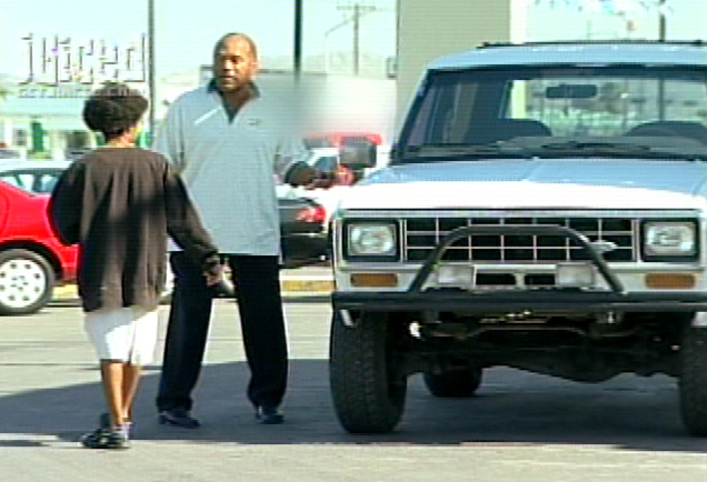 Description of . This undated still image, taken from video and released by Xtreme Entertainment Group, shows O.J. Simpson trying to sell his infamous white Ford Bronco in a scene from his show,