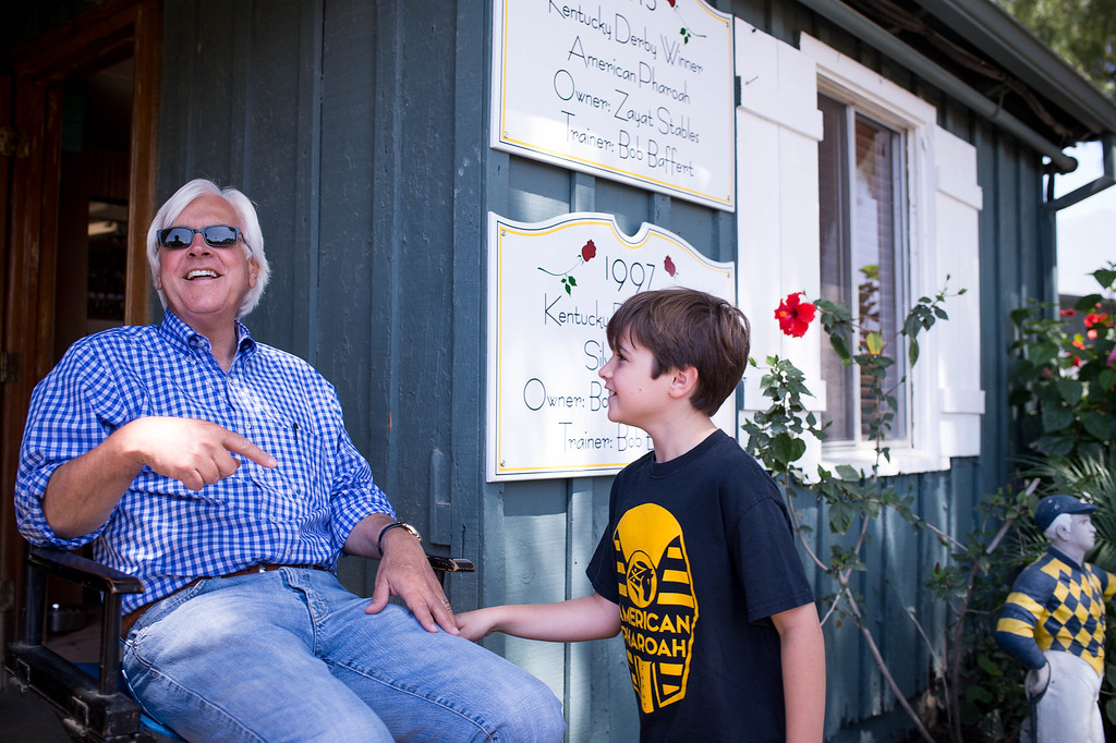. Trainer Bob Baffert and his 10-year-old son Bode wait for Triple Crown-winner American Pharoah to return home to Baffert\'s barn at Santa Anita Thursday, June 18, 2015. American Pharoah broke a 37-year Triple Crown drought by winning the Kentucky Derby, Preakness and Belmont Stakes. (Photo by Sarah Reingewirtz/Pasadena Star-News)