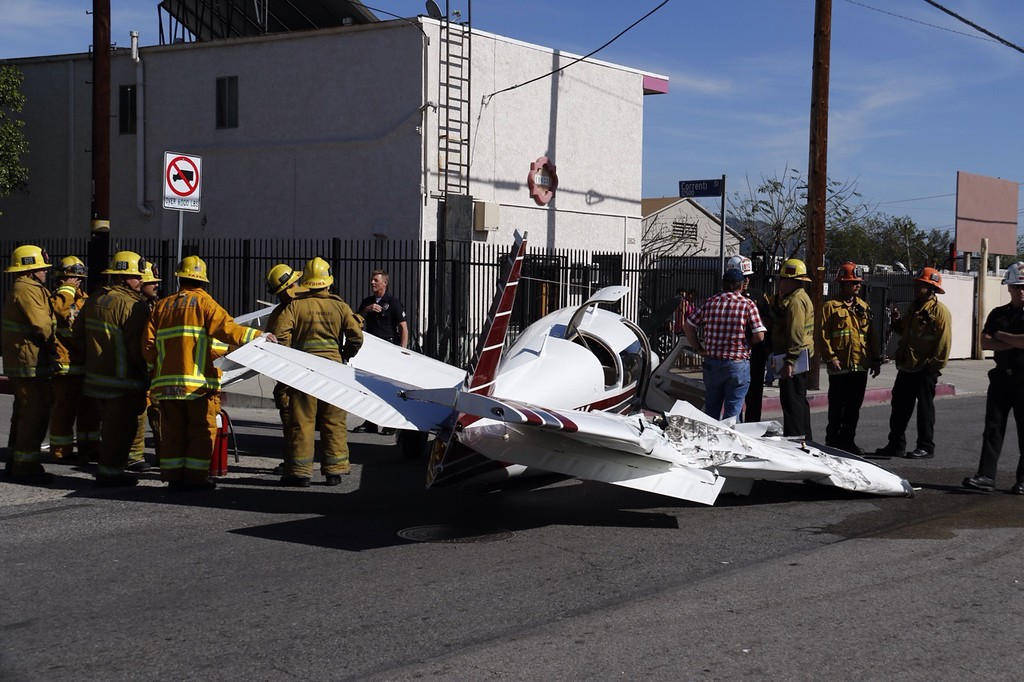 . A small plane crashed about 1:35 p.m. Monday, Feb. 22, 2016, on Little San Fernando Road, just south of Osbourne Street -- and also just south of Whiteman Airport in Pacoima. The aircraft struck multiple vehicles before hitting the ground. Its left wing was severly damaged, its right completely torn off. The pilot, seen wearing a red checked shirt, appeared to suffer no injuries. (Photos by Gene Blevins/Special to the Los Angeles Daily News)