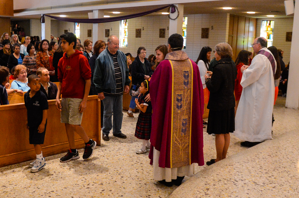 Description of . Parishioners line up to receive ashes on their forehead during Ash Wednesday at the Holy Name of Jesus Catholic Community, Inc. in Redlands, CA on Wednesday, March 5, 2014. Ash Wednesday marks the beginning of Lenten season, a holy time when Catholics prepare for Easter. (Photo by Rachel Luna / Redlands Daily Facts)