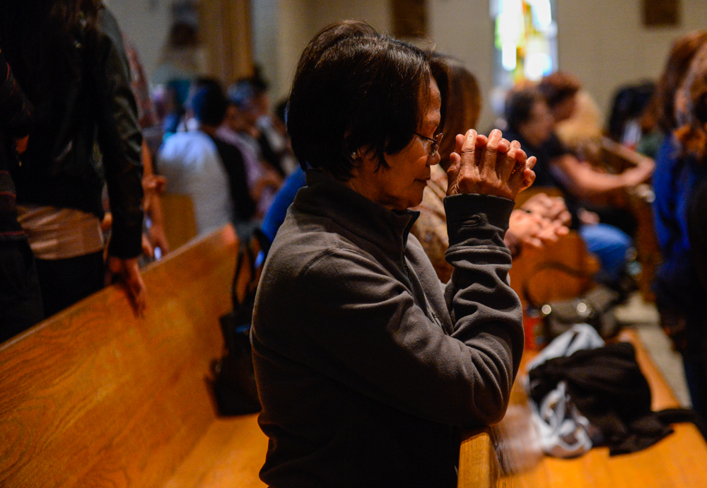 Description of . Parishioners attend church during Ash Wednesday at the Holy Name of Jesus Catholic Community, Inc. in Redlands, CA on Wednesday, March 5, 2014. Ash Wednesday marks the beginning of Lenten season, a holy time when Catholics prepare for Easter. (Photo by Rachel Luna / Redlands Daily Facts)