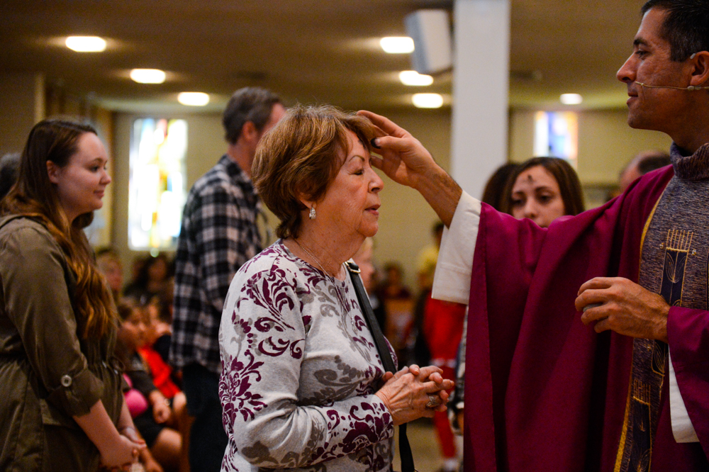 . Parishioners receive ashes on their forehead during Ash Wednesday at the Holy Name of Jesus Catholic Community, Inc. in Redlands, CA on Wednesday, March 5, 2014. Ash Wednesday marks the beginning of Lenten season, a holy time when Catholics prepare for Easter. (Photo by Rachel Luna / Redlands Daily Facts)