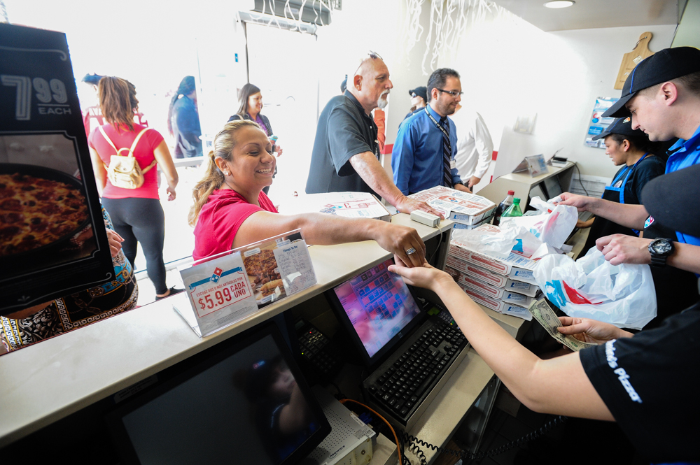 . Customers order Domino\'s Pizza and make donations during an-all-day memorial fundraiser for slain manager Nelly Kantun, who worked as a Domino\'s employee for more than 20 years and was gunned down at the restaurant on Feb. 12, at Domino\'s Pizza on Highland Avenue in San Bernardino, CA on Wednesday, Feb. 19, 2014. One-hundred percent of the proceeds earned Wednesday were donated to the memorial fund. (Photo by Rachel Luna / San Bernardino Sun)
