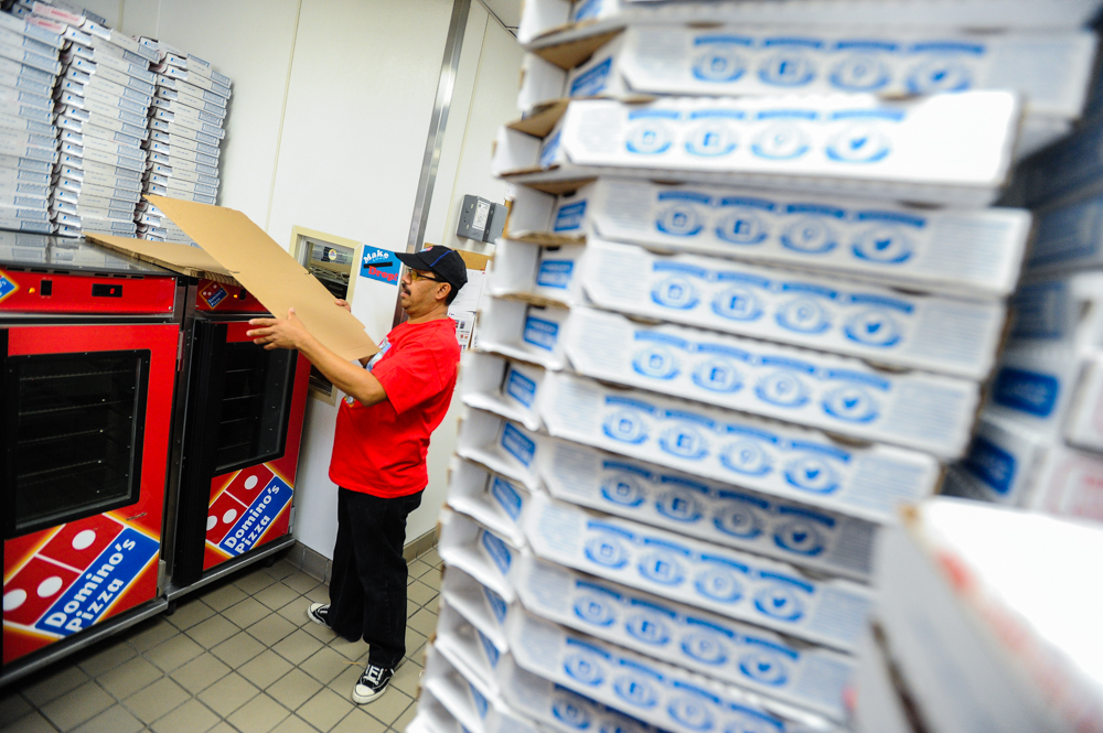 . Antonio Huerta, brother-in-law of slain Domino\'s Pizza manager Nelly Kantun, assembles pizza boxes during an-all-day memorial fundraiser for her aunt at Domino\'s Pizza on Highland Avenue in San Bernardino, CA on Wednesday, Feb. 19, 2014. Kantun, who worked as a Domino\'s employee for more than 20 years, was gunned down at the pizza location on Feb. 12.  (Photo by Rachel Luna / San Bernardino Sun)