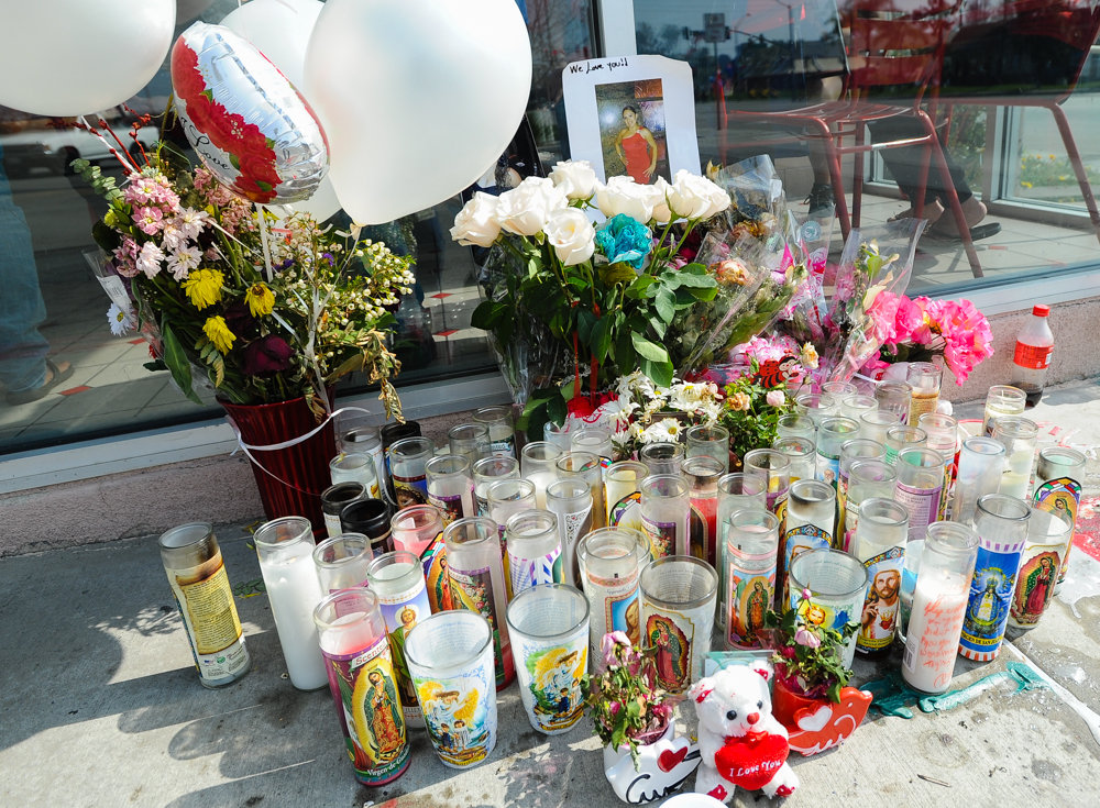 . A memorial is displayed outside Domino\'s Pizza during an-all-day memorial fundraiser for slain manager Nelly Kantun at Domino\'s Pizza on Highland Avenue in San Bernardino, CA on Wednesday, Feb. 19, 2014. Kantun, who worked as a Domino\'s employee for more than 20 years, was gunned down at the pizza location on Feb. 12. (Photo by Rachel Luna / San Bernardino Sun)