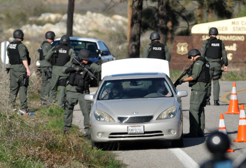 Description of . San Bernardino County Sheriffs, assisted by multiple agencies from the region, block Highway 38 at Bryant St. following a gunfight with Christopher Dorner further up the highway. Dorner shot two police officer, killing one and injuring the other, both men were transported to Loma Linda University Medical Center for treatment, Tuesday, Feb. 12, 2013. (Staff photo by Gabriel Luis Acosta/The Sun)