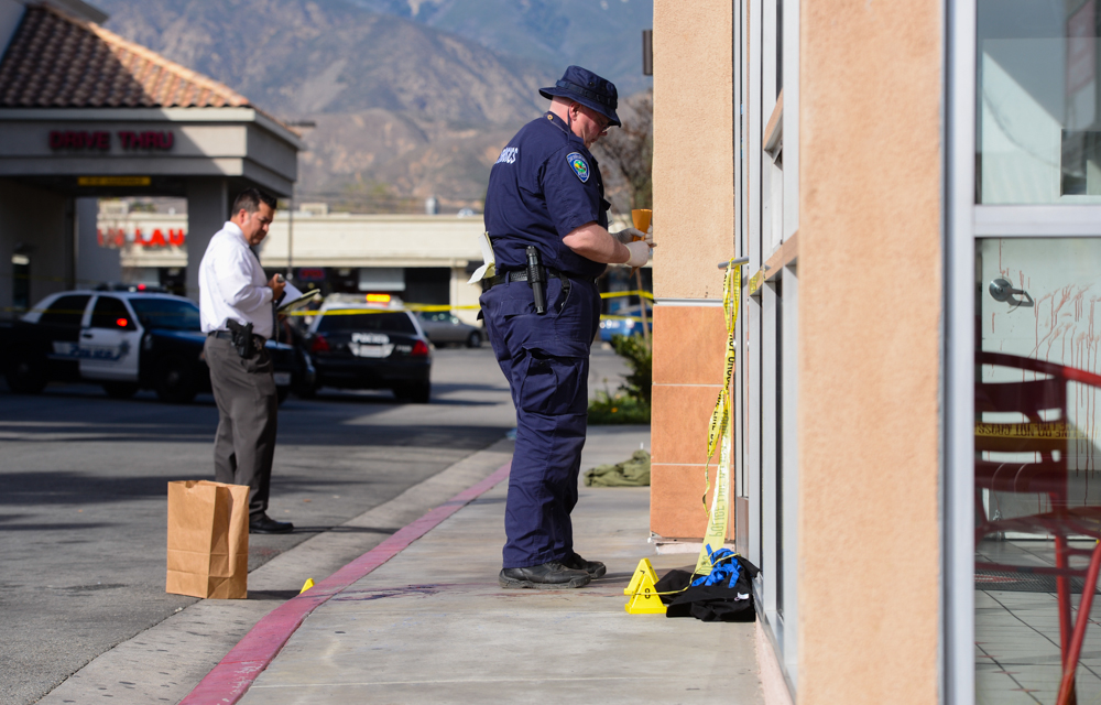 . Police investigate the scene of a homicide that took place inside Domino\'s Pizza on the 1600 block of E. Highland Avenue in San Bernardino, CA on Wednesday, Feb. 12, 2014. The female victim, who was a worker at Domino\'s Pizza, was pronounced dead at the hospital, according to authorities. (Photo by Rachel Luna / San Bernardino Sun)
