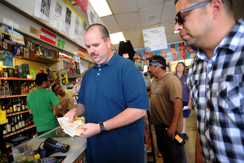 Description of . Norman Seeman buys 00 worth of Powerball tickets at Alcon Liquor in Canoga Park, CA Friday.  The liquor store is listed as a