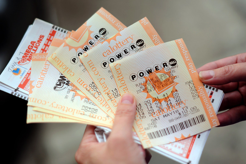 Description of . Powerball tickets are purchased at Alcon Liquor in Canoga Park, CA Friday.  The liquor store is listed as a