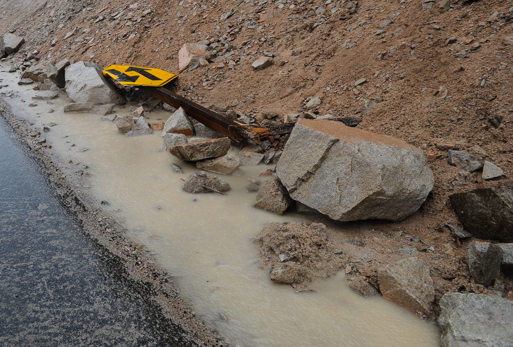 Description of . Fallen rocks and crush a road sign along Highway 18 in Big Bear Lake, CA on Friday, Feb. 28, 2014. Rock and mudslides from heavy rainfall caused the road closure between Running Springs and Big Bear Lake. (Photo by Rachel Luna / San Bernardino Sun)