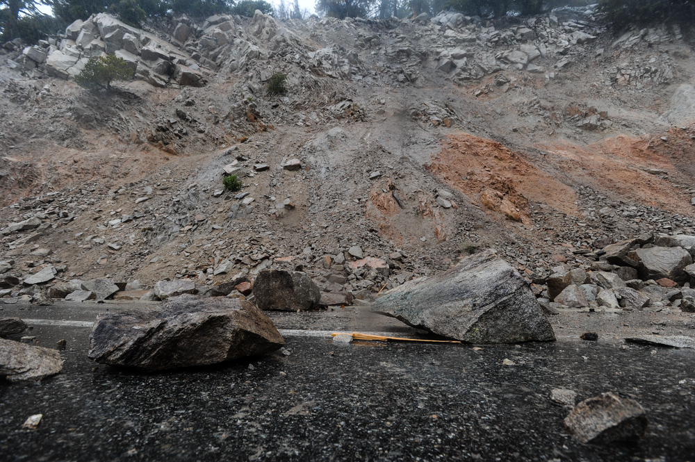 . Fallen rocks and mudslides obstruct Highway 18 in Big Bear Lake, CA on Friday, Feb. 28, 2014. Rock and mudslides from heavy rainfall caused the road closure between Running Springs and Big Bear Lake. (Photo by Rachel Luna / San Bernardino Sun)