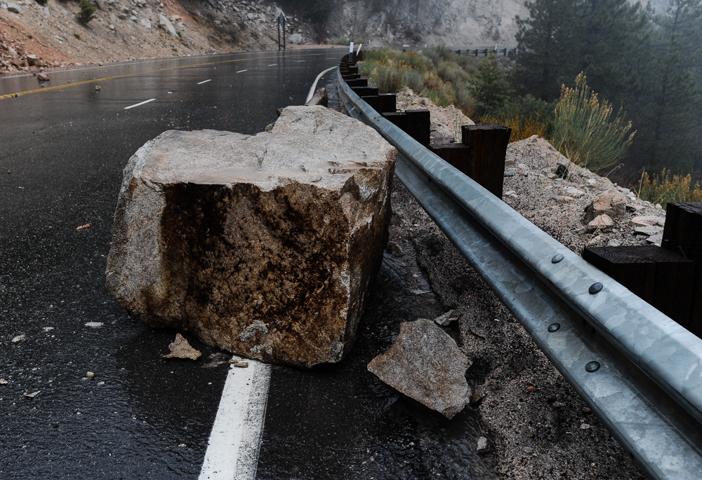 Description of . Fallen rocks and mudslides obstruct Highway 18 in Big Bear Lake, CA on Friday, Feb. 28, 2014. Rock and mudslides from heavy rainfall caused the road closure between Running Springs and Big Bear Lake. (Photo by Rachel Luna / San Bernardino Sun)