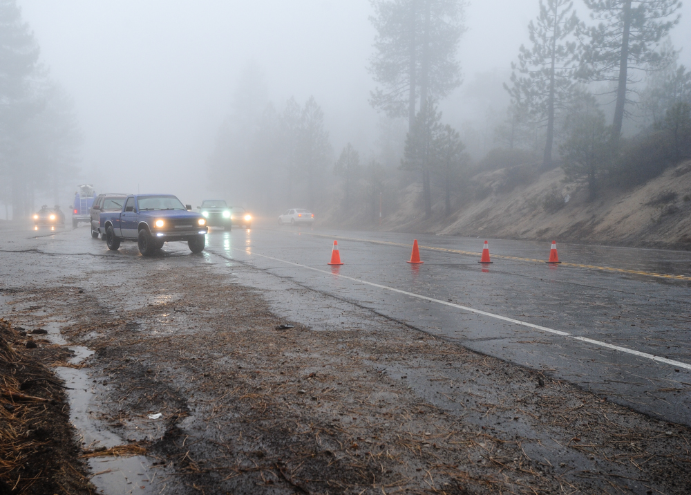 Description of . Highway 18 is closed-off to traffic in Running Springs, CA on Friday, Feb. 28, 2014. Rock and mudslides from heavy rainfall caused the road closure between Running Springs and Big Bear Lake. (Photo by Rachel Luna / San Bernardino Sun)