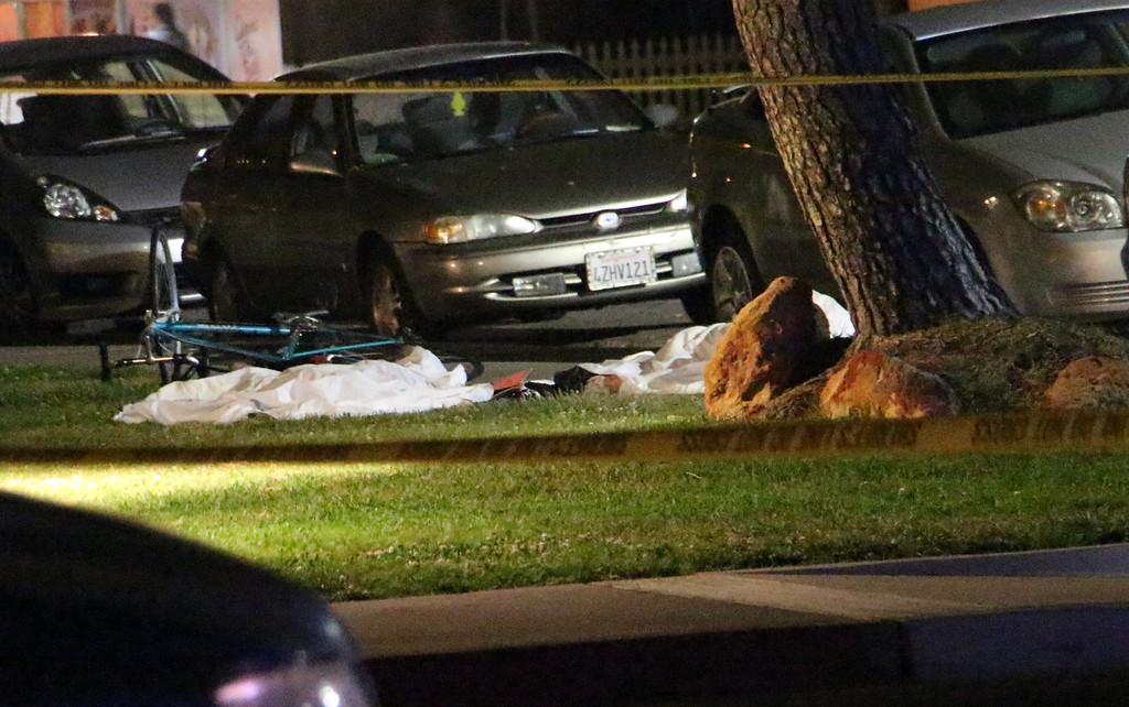""". In this image provided by KEYT-TV, bodies are seen covered on the ground after a mass shooting near the campus of the University of Santa Barbara in Isla Vista, Calif., Friday, May 23, 2014.  A drive-by shooter went on a \""""mass murder\"""" rampage near the Santa Barbara university campus that left seven people dead, including the attacker, and seven others wounded, authorities said Saturday. (AP Photo/KEYT, John Palminteri)"""