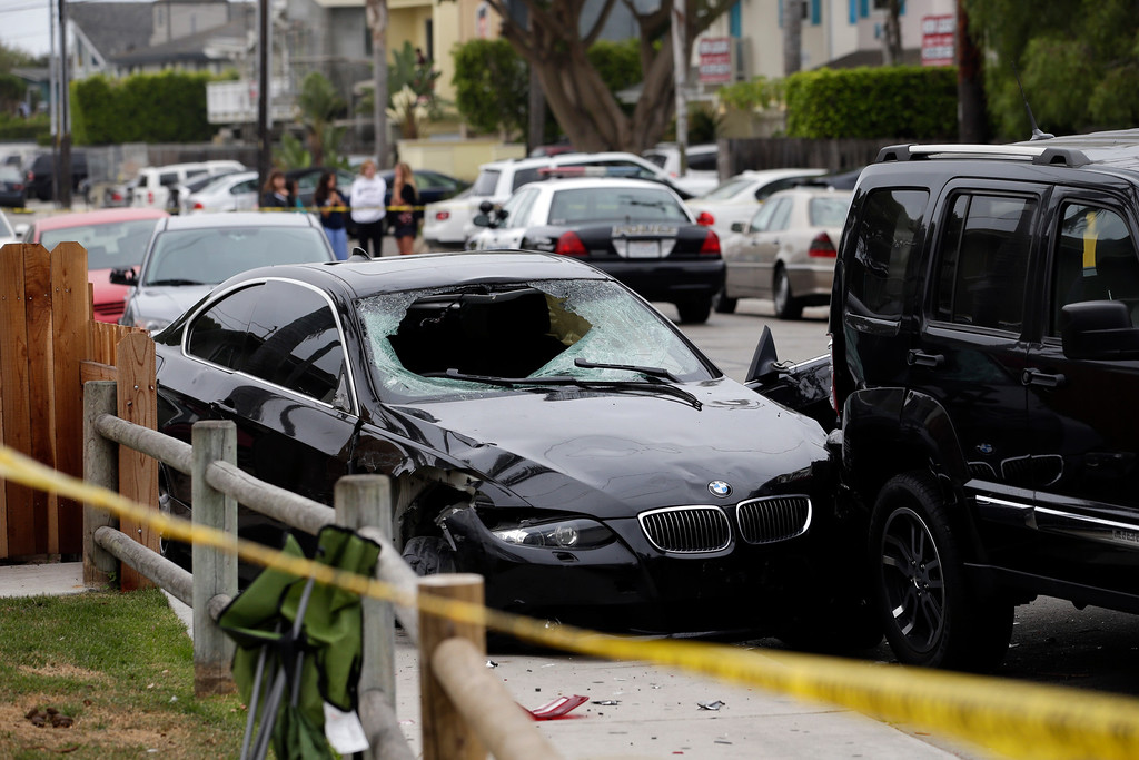 . A black BMW sedan driven by a drive-by shooter is seen on Saturday, May 24, 2014, in Isla Vista, Calif. The shooter went on a rampage near a Santa Barbara university campus that left seven people dead, including the attacker, and seven others wounded, authorities said Saturday. (AP Photo/Jae C. Hong)