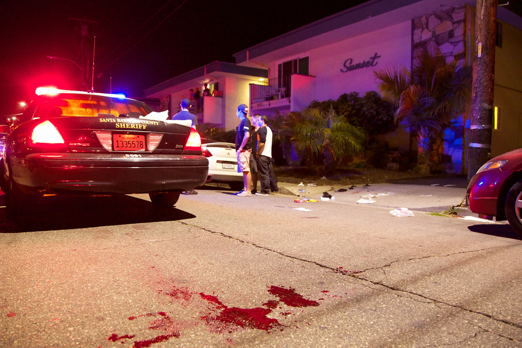 . Police investigate the scene of a drive-by shooting that left seven people dead, including the attacker, and others wounded on Friday, May 23, 2014, in Isla Vista, Calif. Alan Shifman an attorney for Hollywood director Peter Rodger, who was an assistant director on The Hunger Games, said the family believes Rodger\'s son, Elliot Rodger, is responsible for the shooting rampage near the Santa Barbara, California, university campus. Authorities have not confirmed the identity of the shooter. (AP Photo/The News-Press, Peter Vandenbelt)