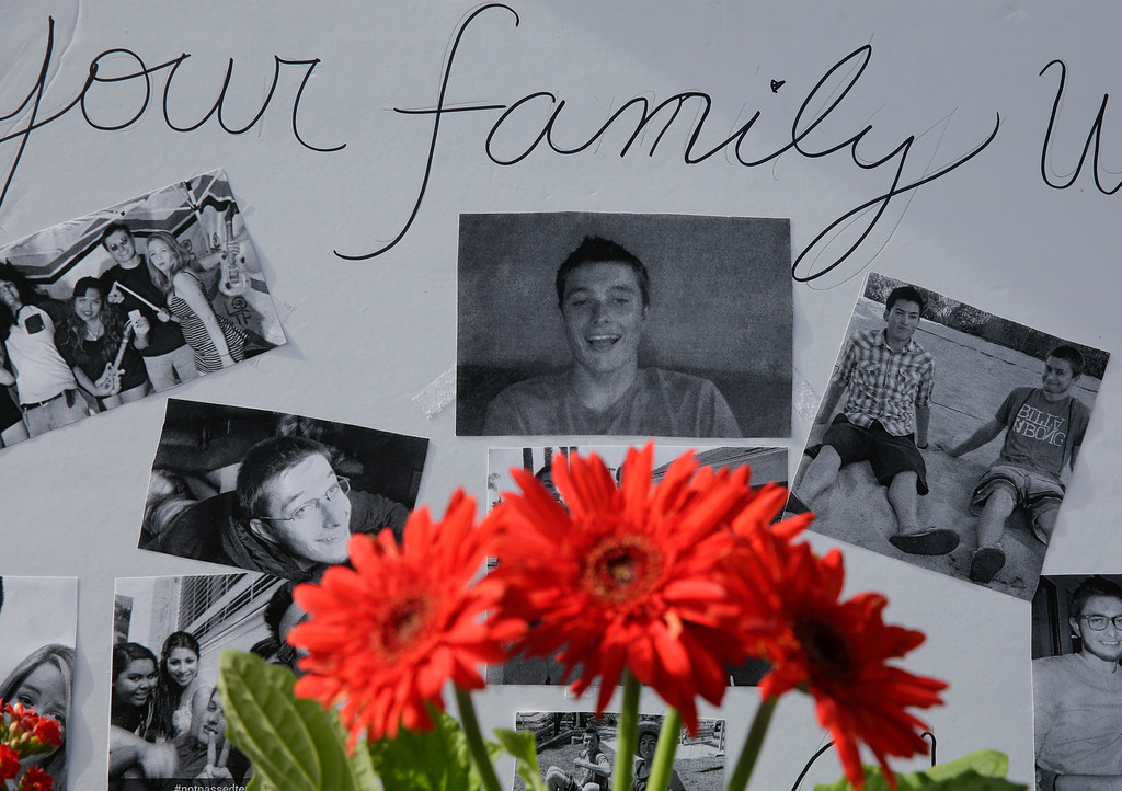 . Images of Christopher Martinez are displayed as part of a memorial in front of the IV Deli Mart, where part of Friday night\'s mass shooting took place, on Sunday, May 25, 2014, in the Isla Vista beach community of Santa Barbara, Calif. Sheriff\'s officials said Elliot Rodger, 22, went on a rampage near the University of California, Santa Barbara, stabbing three people to death at his apartment before shooting and killing three more in a crime spree through a nearby neighborhood. (AP Photo/Chris Carlson)