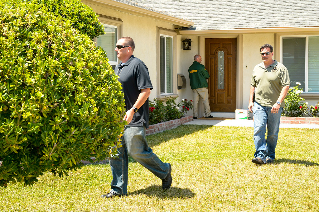 . A Santa Barbara County Sheriff and ATF members the home of Chin Rodger in the 23000 block of Windom street in West Hills, CA.  Rodger is the mother of Elliott Rodger who is suspected of killing 6 people Friday night in Isla Vista, CA. near the campus of UCSB.  Santa Barbara County Sheriff and ATF searched the home Sunday.    May 25, 2014 ( Photo by David Crane/Los Angeles Daily News )