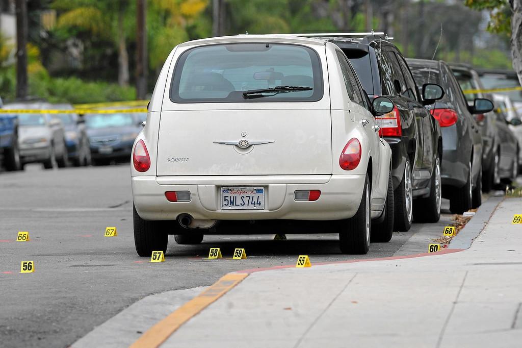 . Evidence indicators along Sabado Tarde Road at the scene of Friday night\'s shooting in Isla Vista, Saturday, May 24, 2014. (Photo by Michael Owen Baker/Los Angeles Daily News)