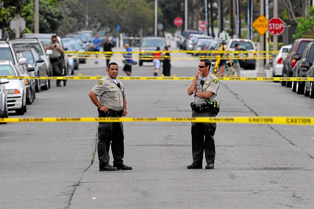 . Police tape closes Sabado Tarde Road in Isla Vista, Saturday, May 24, 2014. (Photo by Michael Owen Baker/Los Angeles Daily News)