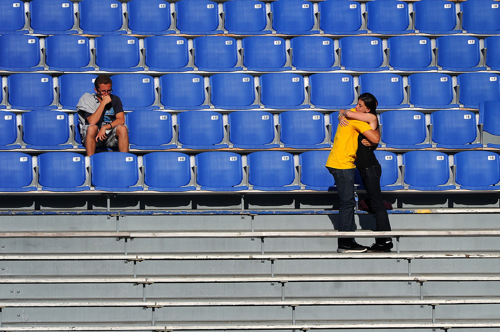 . A couple embraces following a memorial service at Harder Stadium at UCSB for the victims of Friday\'s Isla Vista rampage, Tuesday, May 27, 2014. (Photo by Michael Owen Baker/Los Angeles Daily News)