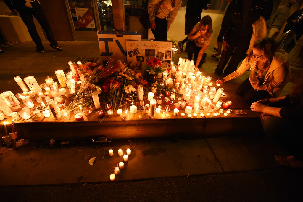 """. Candles in the shape of a number \""""7\"""" for the seven dead - six victims and the shooter - in a killing rampage May 24, 2014 are seen at a makeshift memorial in Santa Barbara May 24, 2014.   Authorities said the 22-year-old lone gunman, Elliot Rodger  the son of a director who worked on the \""""The Hunger Games\""""  killed six people.  Rodger also died in the attack.          (ROBYN BECK/AFP/Getty Images)"""