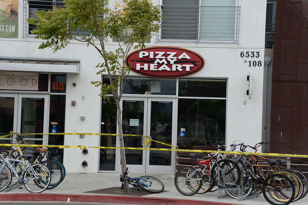 """. The Pizza My Heart restaurant is corndoned off by police tape on May 24, 2014, after a drive-by shooting in Isla Vista, California, a beach community next to the University of California Santa Barbara. Seven people, including the gunman, were killed and seven others wounded in the May 23 mass shooting, Santa Barbara County Sheriff Bill Brown said Saturday. Brown said at a pre-dawn press conference that the shooting in the town of Isla Vista \""""appears to be a mass murder situation.\"""" Driving a black BMW, the suspect opened fire on pedestrians from his vehicle at several locations in the town.            (ROBYN BECK/AFP/Getty Images)"""
