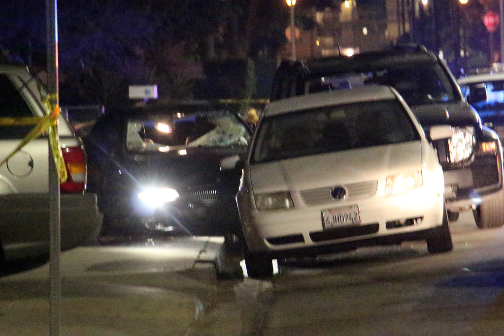 """. In this image provided by KEYT-TV, a car window is shot out after a mass shooting near the campus of the University of Santa Barbara in Isla Vista, Calif., Friday, May 23, 2014.  A drive-by shooter went on a \""""mass murder\"""" rampage near the Santa Barbara university campus that left seven people dead, including the attacker, and seven others wounded, authorities said Saturday. (AP Photo/KEYT, John Palminteri)"""