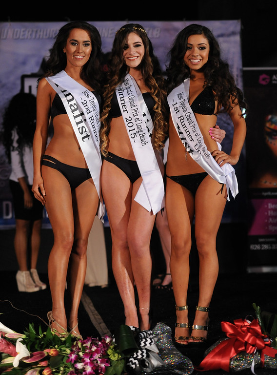. Miss Toyota Grand Prix of Long Beach 2nd runner up Erica Abke ,left, the new 2015 Miss Toyota Grand of Long Beach Natasha Alhandy-Shaw, center, and  1st runner-up Alliyah Becerra during the 15th annual Thunder Thursday on Pine, an event hosted Thursday by the Downtown Long Beach Associates. The free event centered around Pine Avenue and Broadway, featuring live music, driver autographs, a classic car show, a pit stop competition, motorcycle stunts and the Miss Toyota Grand Prix of Long Beach Pageant. Event is from 6:30-10 p.m. Long Beach  Calif., Thursday,  April,16, 2015.     (Photo by Stephen Carr / Daily Breeze)
