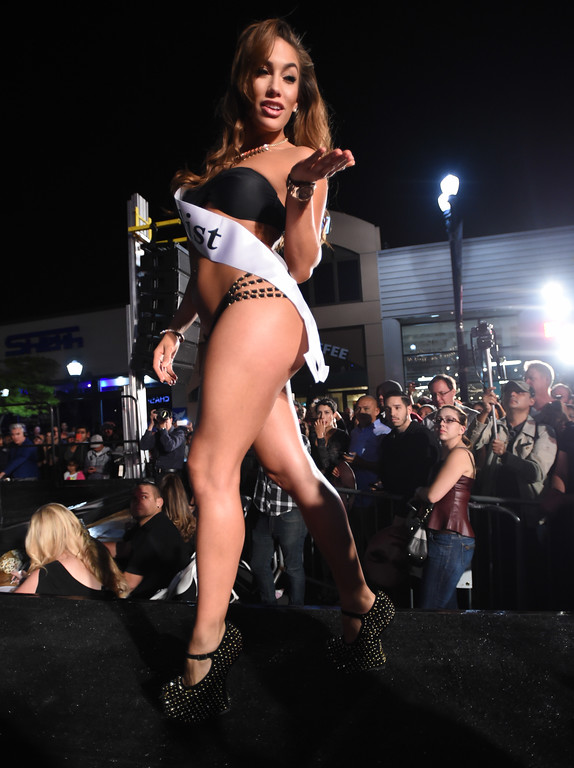 . The 2015 Miss Toyota Grand of Long Beach contest,  during the 15th annual Thunder Thursday on Pine, an event hosted Thursday by the Downtown Long Beach Associates. The free event centered around Pine Avenue and Broadway, featuring live music, driver autographs, a classic car show, a pit stop competition, motorcycle stunts and the Miss Toyota Grand Prix of Long Beach Pageant. Event is from 6:30-10 p.m. Long Beach  Calif., Thursday,  April,16, 2015.     (Photo by Stephen Carr / Daily Breeze)