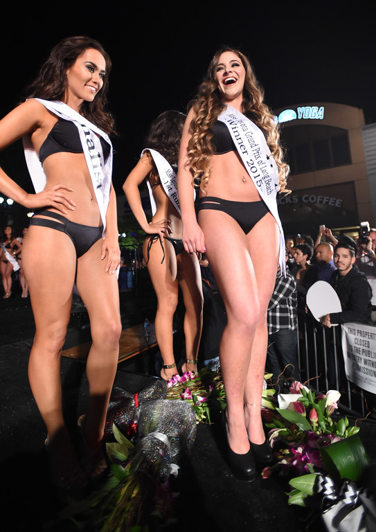 . The new 2015 Miss Toyota Grand of Long Beach Natasha Alhandy-Shaw, right, during the 15th annual Thunder Thursday on Pine, an event hosted Thursday by the Downtown Long Beach Associates. The free event centered around Pine Avenue and Broadway, featuring live music, driver autographs, a classic car show, a pit stop competition, motorcycle stunts and the Miss Toyota Grand Prix of Long Beach Pageant. Event is from 6:30-10 p.m. Long Beach  Calif., Thursday,  April,16, 2015.     (Photo by Stephen Carr / Daily Breeze)