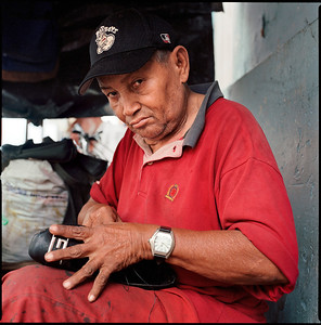 Central market, Granada, Nicaragua.  Shoemaker.