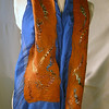 Scroll.  Group C.<br /> <br /> Color-drenched supersoft pumpkin merino, felted into 8mm silk habutai, hand-dyed to a jewelly royal blue (8mm is a medium weight -- harder and longer to felt through, but it provides denser color and more body). Multicolor tencel embellishments for shine and polish. <br /> <br /> The silk side has a heather of wool over the exposed silk, and that scrunchy nuno texture we prize. <br /> <br /> Colors reminded me of vivid Oriental wall scrolls, hence the name. They'll ask: Who is that mysterious confident lady?<br /> <br /> A generous 62x13 inches. <br /> <br /> Hand wash lukewarm/gentle, roll in towel, dry flat or hang to dry, touchup iron the ruffles if you want. <br /> <br /> Monitors vary. I checked color on two; they looked pretty different. Tried to average for general accuracy.