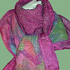 """Celebration"".  Ultra-soft Blue Faced Leicester wool in a rainbow of bright pastels, hand felted onto hand-dyed rose/fuschia silk habutai, embellished with a touch of matching ribbon. <br /> <br /> Reverse side is all exposed silk, with lots of that delicious nuno scrunch. Wear this work of art to add a pop of color to a drab day or night. Light but warm.<br /> <br /> Twelve inches wide; a generous 74"" long -- plenty to loop and swag around around your delicate neck; raw ruffled edges for extra floaty-factor. <br /> <br /> Hand wash lukewarm/gentle, roll in towel, dry flat or hang to dry, touchup iron the ruffles if you want. <br /> <br /> Monitors vary. I checked color on two; they looked pretty different. Tried to average for general accuracy. But your results may differ. This silk background is best described as fairly intense rose or fuschia.<br /> <br /> Price group C"