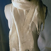 "Ice.  Group B.<br /> <br /> Natural ivory merino hand-felted onto white silk habutai, with tencel highlights for shine and polish.<br /> <br /> A generous 10 x 68 (including fringe, tip to tip; 60"" not counting the fringe).<br /> <br /> Distinctive and elegant. Light but warm, though probably not a solution for Sitka. <br /> <br /> Hand wash lukewarm/gentle, roll in towel, dry flat or hang to dry, touchup iron the edges if you want."