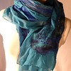 Angelina 1.  Group C.<br /> <br /> Patches of supersoft, hand-dyed merino wool: teal, navy, and Chagall blue, hand- felted into hand-dyed 5mm teal silk chiffon. Hand rolled hem. Beads and copper angelina embellishment, for subltle sparkle and polish. Fiber applied on both sides, giving lots of that delicious nuno scrunch. <br /> <br /> Eleganza! Wear this to a concert, the theater, or your favolite white-tablecloth restaurant. You'll look great.<br /> <br /> Hand wash lukewarm/gentle, roll in towel, dry flat or hang to dry, touchup iron the edges if you want. <br /> <br /> Monitors vary. I checked color on two; they looked pretty different. Tried to average for general accuracy. But your results may differ... This is a deep teal background, with soft teal (same dyepot, different fiber) and dark navy merino, and intense sapphire blue merino/silk blend.